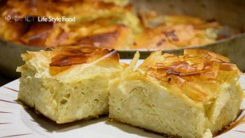 Macaroni pie with three different kinds of cheese